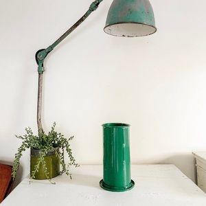 Green vintage metal tube